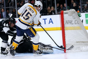 Craig Smith #15 of the Nashville Predators shoots and scores a power play goal to tie the score at 1-1 in the second period past goali Joanthan Quick #32 and Robyn Regehr #44 of the Los Angeles Kings at Staples Center on March 14, 2015 in Los Angeles, California.