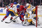 Goaltender Pekka Rinne #35 of the Nashville Predators defends his net as teammate Nick Bonino #13 challenges Byron Froese #42 of the Montreal Canadiens during the NHL game at the Bell Centre on February 10, 2018 in Montreal, Quebec, Canada.