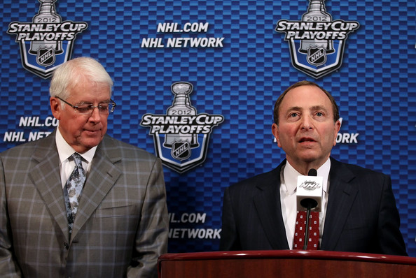 NHL Commissioner Gary Bettman (R) speaks at a press conference to discuss the potential sale of the Phoenix Coyotes to Greg Jamison (L), former CEO of the San Jose Sharks, before the start of Game Five of the Western Conference Semifinals between the Phoenix Coyotes and the Nashville Predators during the 2012 NHL Stanley Cup Playoffs at Jobing.com Arena on May 7, 2012 in Glendale, Arizona.