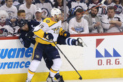 Mattias Ekholm #14 of the Nashville Predators hits Blake Wheeler #26 of the Winnipeg Jets in Game Four of the Western Conference Second Round during the 2018 NHL Stanley Cup Playoffs on May 3, 2018 at Bell MTS Place in Winnipeg, Manitoba, Canada.