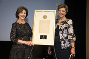 Former First Lady Laura Bush and National Archives Foundation Vice Chair of Board Cokie Roberts onstage during the National Archives Foundation Annual Gala, after Laura Bush was given the Records Of Achievement Award, at The National Archives on October 10, 2018 in Washington, DC.