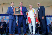 Jim Thome poses for a photograph as he is presented his plaque with (from left) Hall of Fame President Jeff Idelson, Hall of Fame chairman of the board Jane Forbes Clark and MLB commissioner Rob Manfred at Clark Sports Center during the Baseball Hall of Fame induction ceremony on July 29, 2018 in Cooperstown, New York.