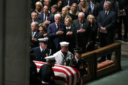 (L-R) Former U.S. President George W. Bush, Laura Bush, Former U.S. President Bill Clinton, former Secretary of State Hillary Clinton, former U.S. Vice President Dick Cheney, Lynne Cheney, and former U.S. Vice President Al Gore stand as the casket is brought in for the funeral service for U.S. Sen. John McCain at the National Cathedral on September 1, 2018 in Washington, DC. The late senator died August 25 at the age of 81 after a long battle with brain cancer. McCain will be buried at his final resting place at the U.S. Naval Academy.