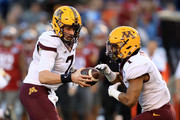 Mitch Leidner #7 hands off to Rodney Smith #1 of the Minnesota Golden Gophers during the first half of the Holiday Bowl against the Washington State Cougars  at  at Qualcomm Stadium on December 27, 2016 in San Diego, California.
