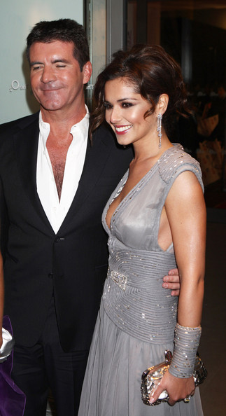 (UK TABLOID NEWSPAPERS OUT) Simon Cowell and Cheryl Cole arrive at the National Television Awards held the at The O2 Arena on January 20, 2010 in London, England.