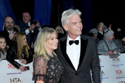 Stephanie Lowe and Phillip Schofield attends the National Television Awards held at the O2 Arena on January 22, 2019 in London, England.