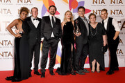 (L-R) Fleur East, Harry Redknapp, Nick Knowles, Emily Atack, John Barrowman, Anne Hegerty and James McVey pose with The Bruce Forsyth Entertainment Award for I'm A Celebrity… Get Me Out Of Here!  during the National Television Awards held at The O2 Arena on January 22, 2019 in London, England.