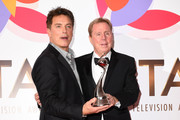 John Barrowman and Harry Redknapp with The Bruce Forsyth Entertainment Award for I'm A Celebrity… Get Me Out Of Here!  during the National Television Awards held at The O2 Arena on January 22, 2019 in London, England.