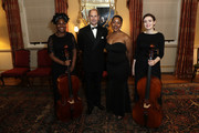 (L-R) Prince Edward, Earl of Wessex (C) poses with National Youth Theatre performers during the National Youth Theatre Baroque And Roll Fundraising Gala 2020 at Spencer House on February 11, 2020 in London, England.