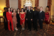 Prince Edward, Earl of Wessex (C) poses with National Youth Theatre performers during the National Youth Theatre Baroque And Roll Fundraising Gala 2020 at Spencer House on February 11, 2020 in London, England.