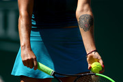 The tiger tattoo of Aryna Sabalenka of Belarus on show during her womens singles semi final match against Agnieszka Radwankska of Poland during Day Eight of the Nature Valley International at Devonshire Park on June 29, 2018 in Eastbourne, United Kingdom.