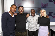 Naughty Boy poses with KISS Breakfast presenters Rickie Haywood Williams, Charlie Hedges and Melvin O'Doom during his visits Kiss FM Studio's on September 23, 2015 in London, England.