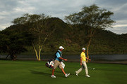 Justin Rose of England walks with his caddie Mark Fulcher down the 17th fairway during the first round of the 2010 Nedbank Golf Challenge at the Gary Player Country Club Course  on December 2, 2010 in Sun City, South Africa.