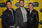"(L-R) Actor Zac Efron, actor Seth Rogan and actor Dave Franco pose for pictures in the green room at the premiere of ""Neighbors"" during the 2014 SXSW Music, Film + Interactive Festival  at the Paramount Theatre on March 8, 2014 in Austin, Texas."