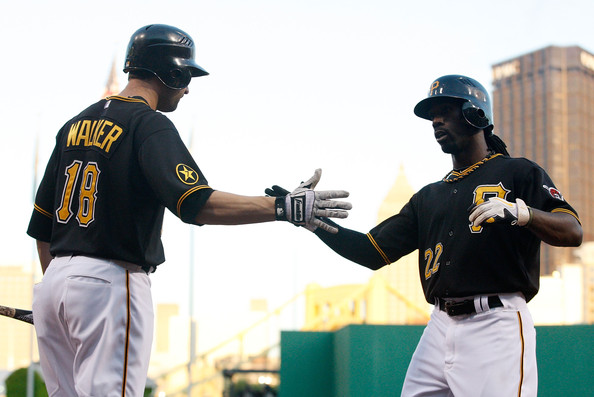 Neil Walker Andrew McCutchen #22 of the Pittsburgh Pirates is congratulated by teammate Neil Walker #18 after hitting a three run home run against the St Louis Cardinals in the third inning during the game on August 16, 2011 at PNC Park in Pittsburgh, Pennsylvania.