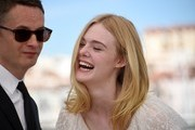 "US actress Elle Fanning (R) laughs while posing on May 20, 2016 with Danish director Nicolas Winding Refn during a photocall for the film ""The Neon Demon"" at the 69th Cannes Film Festival in Cannes, southern France.  / AFP / ANNE-CHRISTINE POUJOULAT"