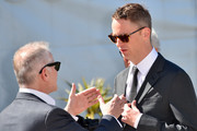 "Danish director Nicolas Winding Refn (R) talks the General Delegate of the Cannes Film festival Thierry Fremaux as he arrives on May 20, 2016 to attend a photocall for the film ""The Neon Demon"" at the 69th Cannes Film Festival in Cannes, southern France.  / AFP / LOIC VENANCE"