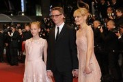 "Danish director Nicolas Winding Refn (C) poses with his wife Liv Corfixen (R) and their daughter Lola pose as they arrive on May 20, 2016 for the screening of the film ""The Neon Demon"" at the 69th Cannes Film Festival in Cannes, southern France.  / AFP / Valery HACHE"