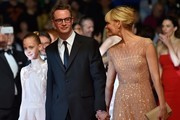 "Danish director Nicolas Winding Refn (C) arrives on May 20, 2016 with his wife Liv Corfixen (R) and daughter Lola for the screening of the film ""The Neon Demon"" at the 69th Cannes Film Festival in Cannes, southern France.  / AFP / LOIC VENANCE"