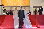 "Danish director Nicolas Winding Refn (C) poses with his wife Liv Corfixen (L) and US actress Elle Fanning as they arrive on May 20, 2016 for the screening of the film ""The Neon Demon"" at the 69th Cannes Film Festival in Cannes, southern France.  / AFP / LOIC VENANCE"
