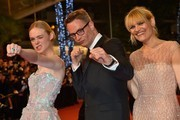 "Danish director Nicolas Winding Refn (C) and US actress Elle Fanning (L) pose with Danish actress and director Liv Corfixen as they arrive on May 20, 2016 for the screening of the film ""The Neon Demon"" at the 69th Cannes Film Festival in Cannes, southern France.  / AFP / LOIC VENANCE"