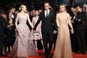 "Danish director Nicolas Winding Refn (C) poses with his wife Liv Corfixen (R) and US actress Elle Fanning as they arrive on May 20, 2016 for the screening of the film ""The Neon Demon"" at the 69th Cannes Film Festival in Cannes, southern France.  / AFP / Valery HACHE"