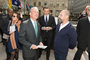 """(L-R) Michael Bloomberg, Frederic Levy and Ugo Rondinone attend Nespresso announces premier partnership with """"Human Nature by Ugo Rondinone"""" Exhibit on April 22, 2013 at Rockefeller Center in New York City."""