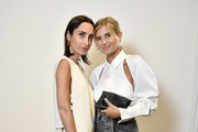 Géraldine Boublil and Xenia Adonts attend NET-A-PORTER cocktail to celebrate a collection of high jewelry on July 03, 2019 in Paris, France.