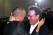 """Aaron Paul (L) and Bryan Cranston attend the World Premiere of  """"El Camino: A Breaking Bad Movie"""" at the Regency Village on October 07, 2019 in Los Angeles, California."""