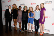 (L-R) Actors Jason Biggs, Laverne Cox, Uzo Aduba, Jenji Kohan, Natasha Lyonne, Netflix VP of Original Content Cindy Holland and actress Taylor Schilling attend Netflix's 'Orange is the New Black' panel discussion at Directors Guild Of America on August 4, 2014 in Los Angeles, California.