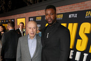 (L-R) Alan Arkin and Winston Duke attend the Netflix Premiere Spenser Confidential at Westwood Village Theatre on February 27, 2020 in Westwood, California.