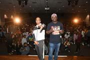 T.I. and Greg Street pose onstage with Clark Atlanta University students during Netflix Presents Rhythm+Flow Atlanta screening at Clark Atlanta University on October 08, 2019 in Atlanta, Georgia.