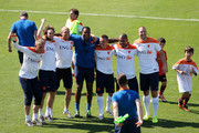 Jasper Cillessen, Daley Blind, Arjen Robben, Patrick Kluivert, Jordy Clasie, Nigel de Jong and Ron Vlaar share a joke and cheer in front of Louis van Gaal, the Netherlands national football team manager during the Netherlands training session at the 2014 FIFA World Cup Brazil held at the Estadio Jose Bastos Padilha Gavea on June 8, 2014 in Rio de Janeiro, Brazil.