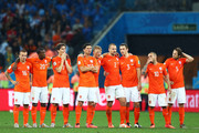 Jordy Clasie, Georginio Wijnaldum, Daryl Janmaat, Klaas-Jan Huntelaar, Dirk Kuyt , Ron Vlaar, Stefan de Vrij,  Wesley Sneijder and Daley Blind of the Netherlands look on during a penalty shootout during the 2014 FIFA World Cup Brazil Semi Final match between the Netherlands and Argentina at Arena de Sao Paulo on July 9, 2014 in Sao Paulo, Brazil.