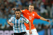 Maxi Rodriguez of Argentina controls the ball against Jordy Clasie of the Netherlands during the 2014 FIFA World Cup Brazil Semi Final match between the Netherlands and Argentina at Arena de Sao Paulo on July 9, 2014 in Sao Paulo, Brazil.
