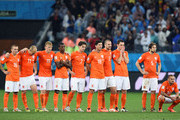 Jordy Clasie, Arjen Robben, Dirk Kuyt, Georginio Wijnaldum, Daryl Janmaat, Klaas-Jan Huntelaar, Ron Vlaar, Stefan de Vrij, Daley Blind and Wesley Sneijder of the Netherlands look on during a penalty shootout during the 2014 FIFA World Cup Brazil Semi Final match between the Netherlands and Argentina at Arena de Sao Paulo on July 9, 2014 in Sao Paulo, Brazil.