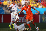 Gonzalo Jara of Chile tackles Arjen Robben of the Netherlands during the 2014 FIFA World Cup Brazil Group B match between the Netherlands and Chile at Arena de Sao Paulo on June 23, 2014 in Sao Paulo, Brazil.