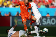 Gonzalo Jara and Mauricio Isla of Chile stop the attacking Arjen Robben (#11) of the Netherlands during the 2014 FIFA World Cup Brazil Group B match between the Netherlands and Chile at Arena de Sao Paulo on June 23, 2014 in Sao Paulo, Brazil.