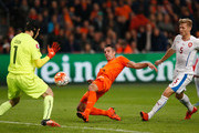 Robin van Persie of the Netherlands beats goalkeeper Petr Cech of the Czech Republic as scores their second goal and his 50th in international matches during the UEFA EURO 2016 qualifying Group A match between the Netherlands and the Czech Republic at Amsterdam Arena on October 13, 2015 in Amsterdam, Netherlands.