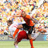 John Heitinga Photos - Nicklas Bendtner of Denmark is tackled by John Heitinga of the Netherlands during the 2010 FIFA World Cup Group E match between Netherlands and Denmark at Soccer City Stadium on June 14, 2010 in Johannesburg, South Africa. - Netherlands v Denmark: Group E - 2010 FIFA World Cup