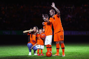 Wesley Sneijder of the Netherlands, Yolanthe Sneijder-Cabau, Xess Xava, Jessey Sneijder wave to the fans after the International friendly match match between The Netherlands and Peru at the Johan Cruijff Arena on September 06, 2018 in Amsterdam, The Netherlands.