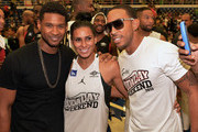 Usher, Laura Govan Basketball Wives of LA and Ludacris during Neuro Drinks At LudaDay Weekend Celebrity Basketball Game at GSU Sports Arena on September 1, 2013 in Atlanta, Georgia.