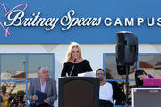 Singer Britney Spears (C) speaks as Clark County Commissioner Steve Sisolak (L) and talent manager Larry Rudolph (2nd R) look on during the grand opening of the Nevada Childhood Cancer Foundation Britney Spears Campus on November 4, 2017 in Las Vegas, Nevada.