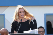 Singer Britney Spears (C) speaks as talent manager Larry Rudolph looks on during the grand opening of the Nevada Childhood Cancer Foundation Britney Spears Campus on November 4, 2017 in Las Vegas, Nevada.