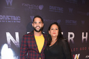 """Dijon Talton and his mom attend """"Never Heard"""" Movie Premiere at AMC CityWalk Stadium 19 at Universal Studios Hollywood on October 30, 2018 in Universal City, California."""