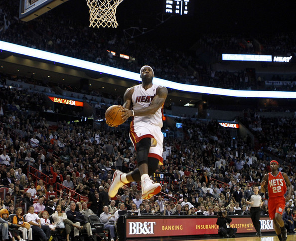 lebron james heat dunking. Forward LeBron James #6 of the