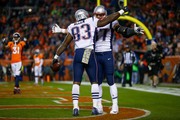 Tight end Dwayne Allen #83 of the New England Patriots celebrates with Rob Gronkowski #87 after scoring a second quarter touchdown against the Denver Broncos at Sports Authority Field at Mile High on November 12, 2017 in Denver, Colorado.