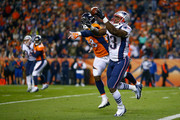Tight end Dwayne Allen #83 of the New England Patriots catches a pass before scoring a second quarter touchdown under coverage by outside linebacker Von Miller #58 of the Denver Broncos at Sports Authority Field at Mile High on November 12, 2017 in Denver, Colorado.