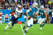 Jay Cutler #6 of the Miami Dolphins scrambles during the fourth quarter against the New England Patriots at Hard Rock Stadium on December 11, 2017 in Miami Gardens, Florida.