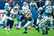 Dion Lewis #33 of the New England Patriots rushes during the second quarter against the Miami Dolphins at Hard Rock Stadium on December 11, 2017 in Miami Gardens, Florida.